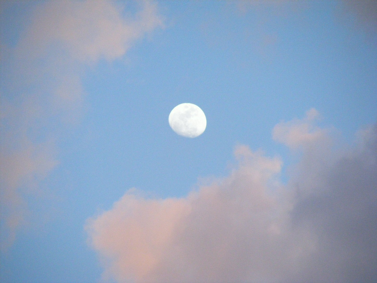Midday Moon Surrounded by Clouds