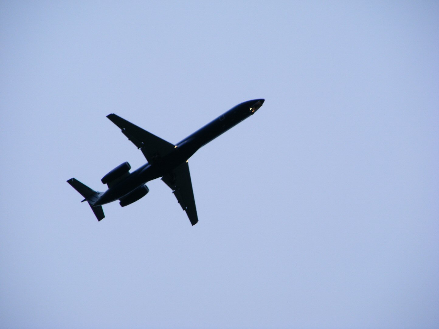 Zoom of Airplane from the Ground on Bright Blue Skies