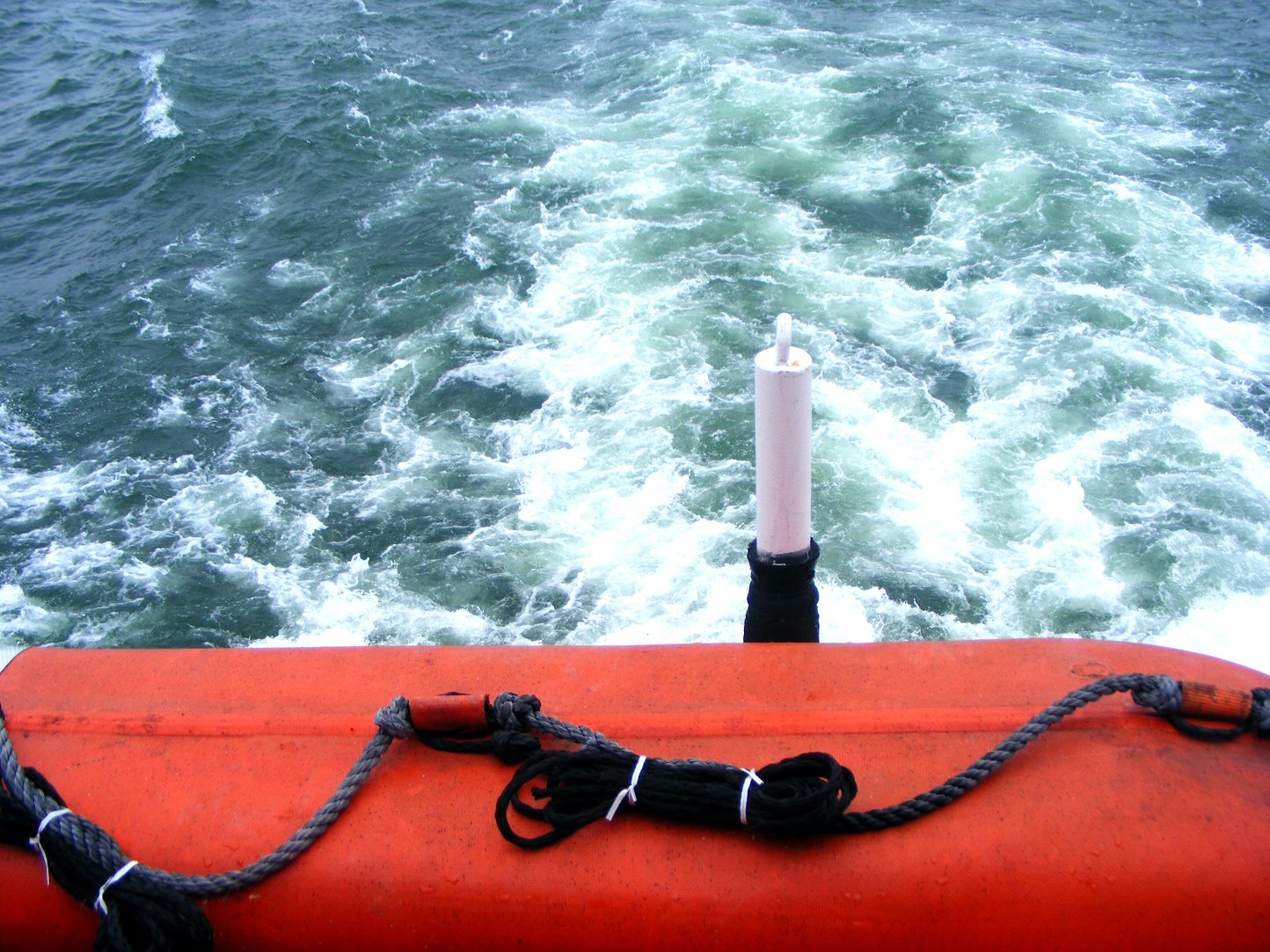 Ruffled Angry Water Behind a Ferry